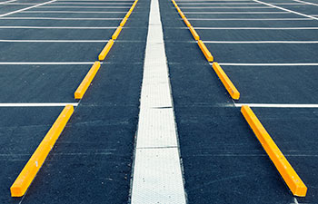 well-maintained parking lot with good quality asphalt and line striping