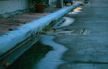 water logging on the street due to catch basin failure